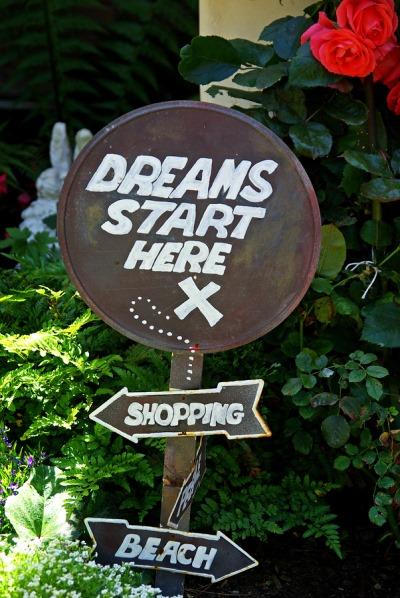 Sign saying that the dreams start here, in Carmel, on California's Pacific Coast Highway.