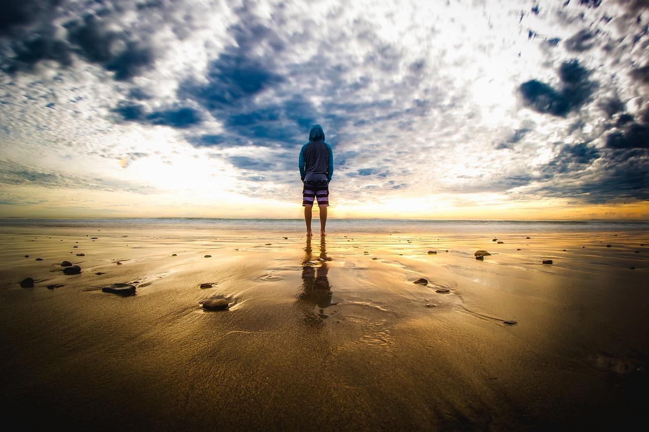 Man on the beach in Malibu, California