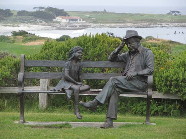 Park bench with statues along the 17-Mile-Drive from Carmel to Pacific Grove