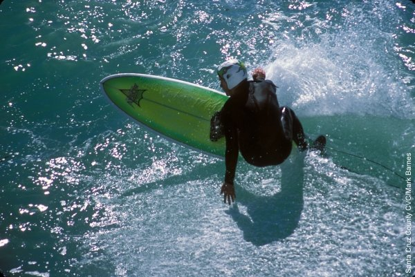 A surfer in Santa Cruz, California, from https://www.pacific-coast-highway-travel.com/Santa-Cruz.html
