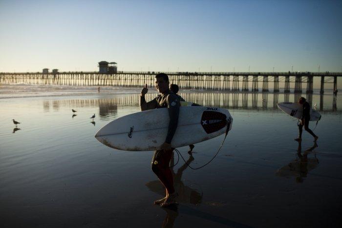 Surfers in Front of Oceanside Pier in Oceanside, southern California