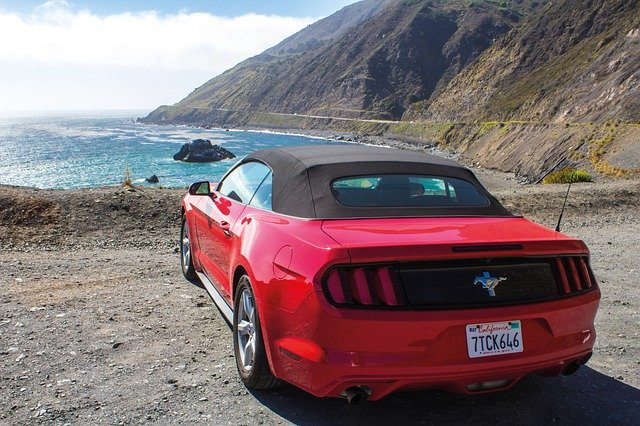 Red Mustang car stopped on the Pacific Coast Highway